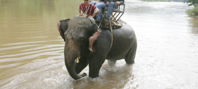 A rare site for my dad. Riding down a river in Thailand.